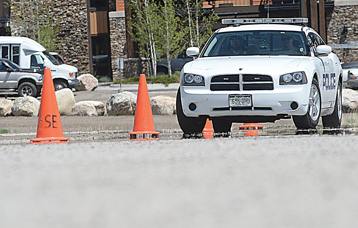 Steamboat Springs police officer Ross Blank trains on an obstacle course in the Meadows Parking Lot on Tuesday afternoon. The session was part of regular drivers training for the department that covers everything from navigating a tight parking lot to emergency maneuvers at high speed.