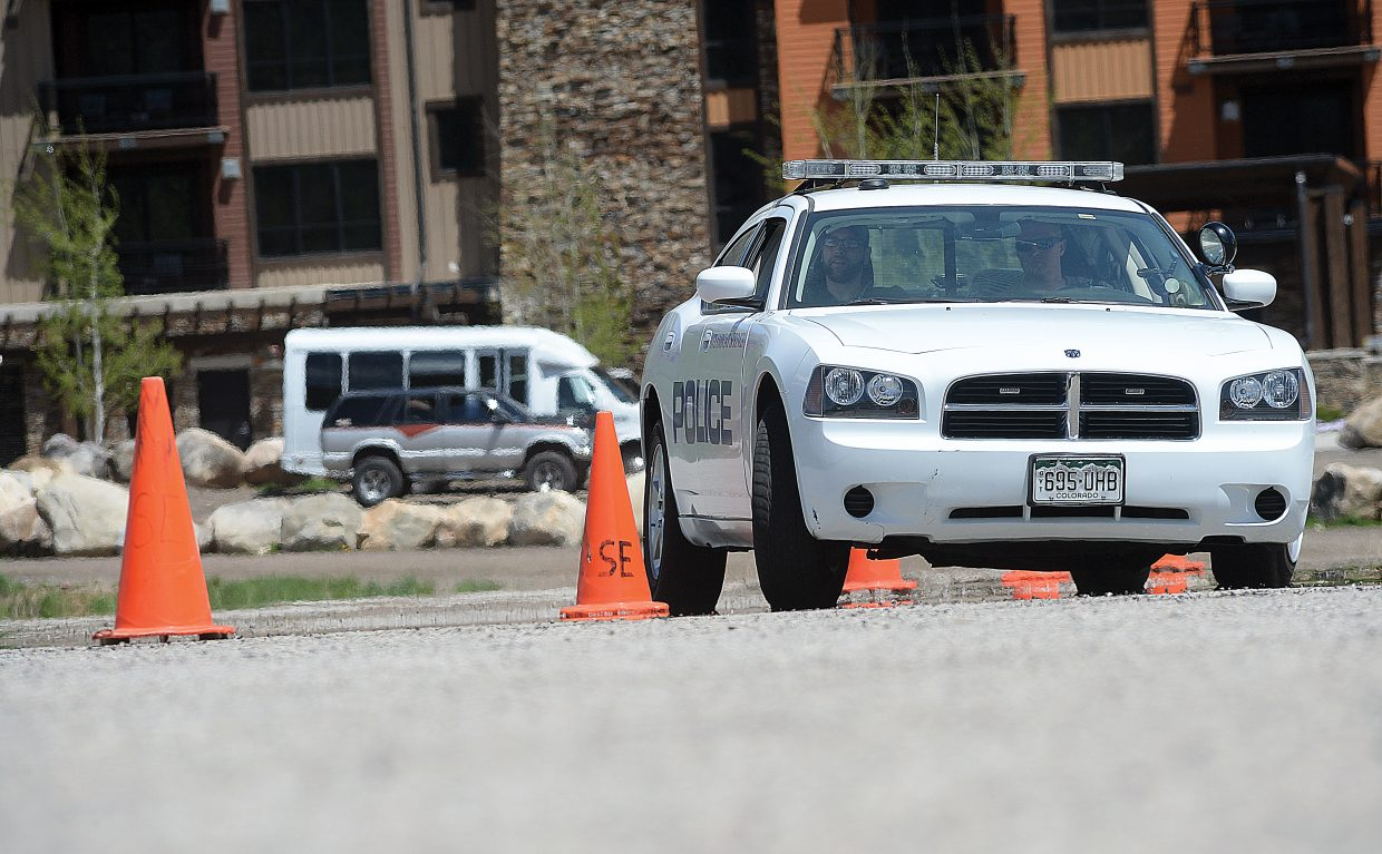 Steamboat Springs Police officer Ross Blank trains on an obstacle course in the Meadows Parking lot Tuesday afternoon. The session was part of regular drivers training for the department that covers everything from navigating a tight parking lot to emergency maneuvers at high speed.