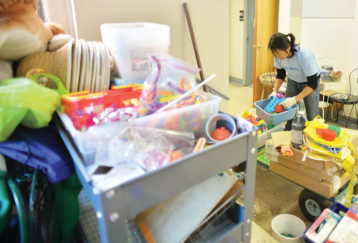 Sue Davies sorts and organizes toys at BOCES Preschool as part of the Routt County United Way's annual Day of Caring. Volunteers completed a number of different projects at sites around the community Wednesday in a showing of community spirit and caring.