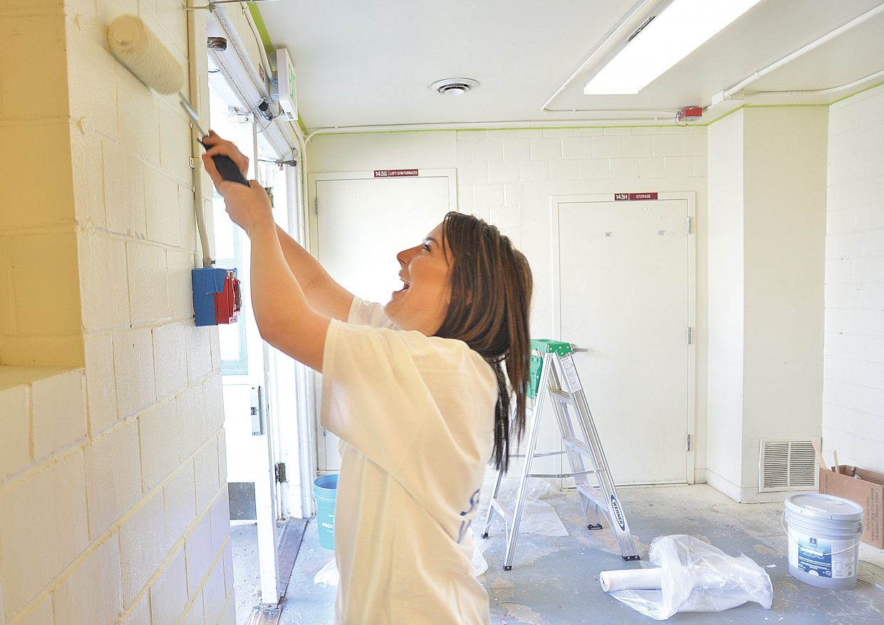 Bank of the West employee Tia Rexford paints the entryway at the Boys & Girls Club of Steamboat Springs Wednesday morning. Rexford, and other members of the Young Professionals Network, volunteered their time as part of the Routt County United Way's annual Day of Caring.