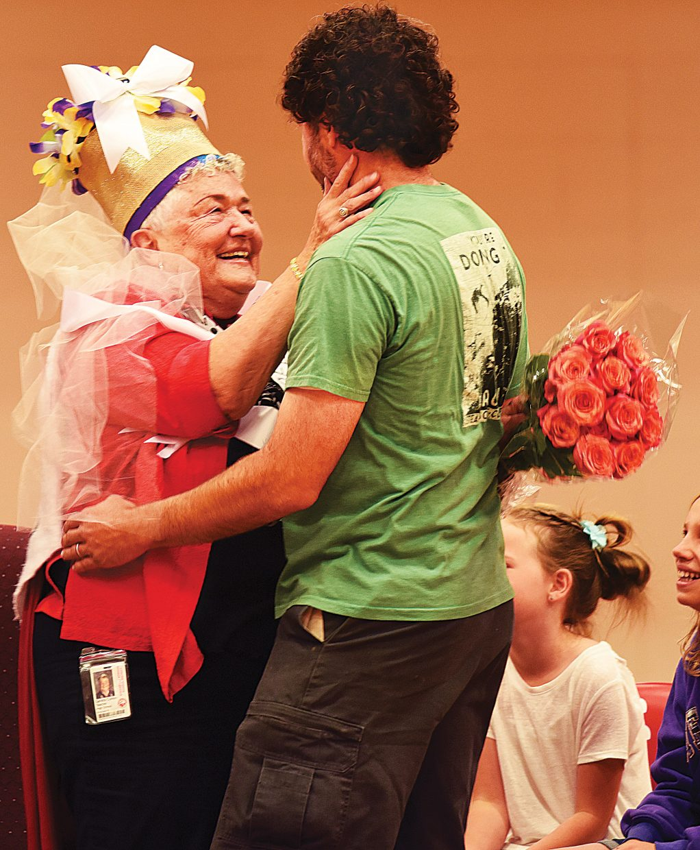 Longtime Steamboat Springs High School teacher Sandy Conlon gets a hug from her son, Fred, during a retirement pep assembly Friday morning. Conlon, who has taught for 56 years, including the past 46 in Steamboat Springs, was caught off guard by a school-wide assembly that included the entire student body, former students and her family members.