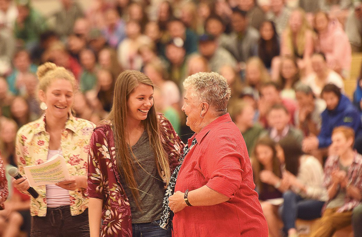 Longtime Steamboat Springs High School teacher Sandy Conlon takes a moment to talk with student Sammie Stevenson during a retirement pep assembly Friday morning. Conlon, who has taught for 56 years including the past 46 in Steamboat Springs, was caught off guard by a school-wide assembly that included the entire student body, former students and her family members.