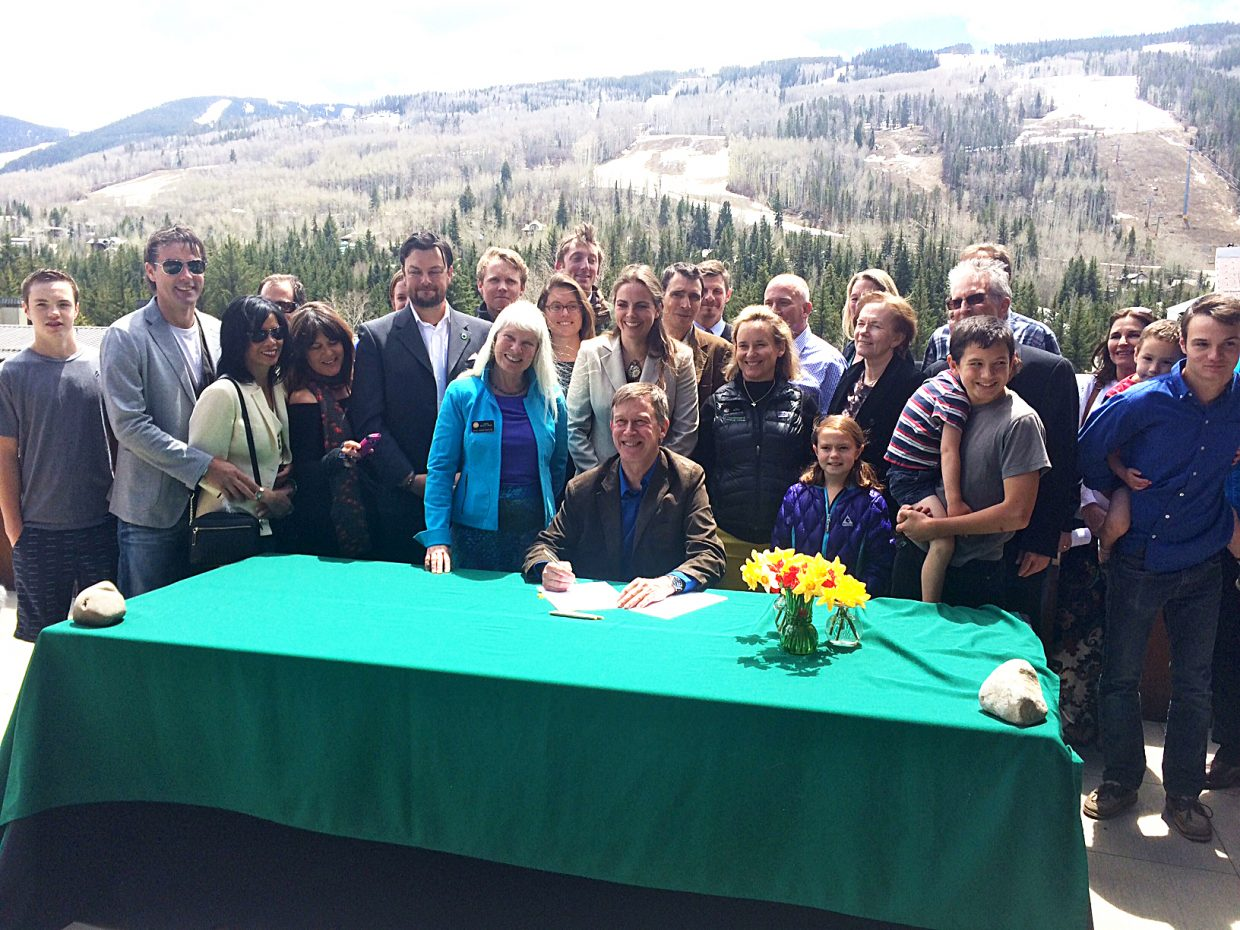 """Gov. John Hickenlooper in Vail surrounded by Senate Bill 21 sponsors, including State House Rep. Diane Mitsch-Bush, of Steamboat Springs, and supporters. Signs bill establishing the nation's first state """"Public Lands Day."""""""
