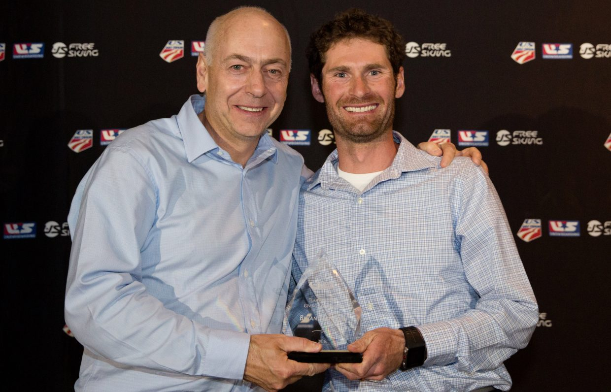 United States Ski and Snowboard Association chairman Dexter Paine and Bryan Fletcher shake hands after he was awarded the Team Athletes Giving Back Award at the Chairman's Awards Dinner during USSA Congress.