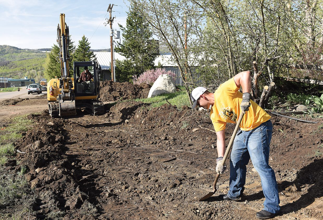 Geoff Petis, a member of Leadership Steamboat's 2016-17 class, helps construct a new sidewalk in front of the property recently purchased by the nonprofit LiftUp of Routt County. The property, located at 2095 Curve Plaza, will serve as the new home of LiftUp's food bank. The class wanted to lead the way in our community by taking on the challenge of building a sidewalk for the valued Steamboat organization.