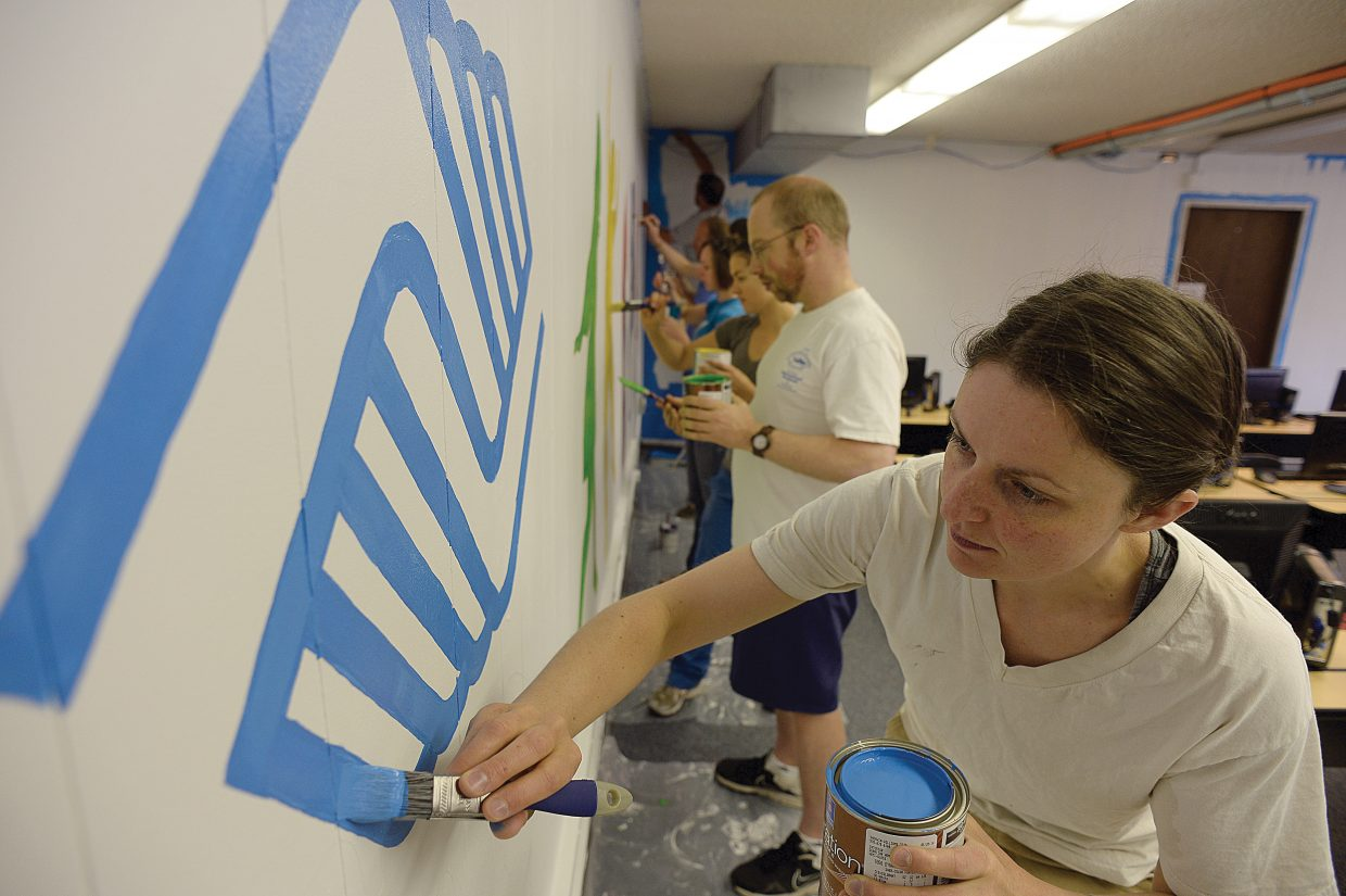 Jackie Kuusinen and a group of volunteers from the Young Professionals Network paint the wall in the computer lab at the Boys & Girls Club of Northwest Colorado on Wednesday morning. The project was one of 19 that volunteers tackled as part of the annual Routt County United Way's Day of Caring.
