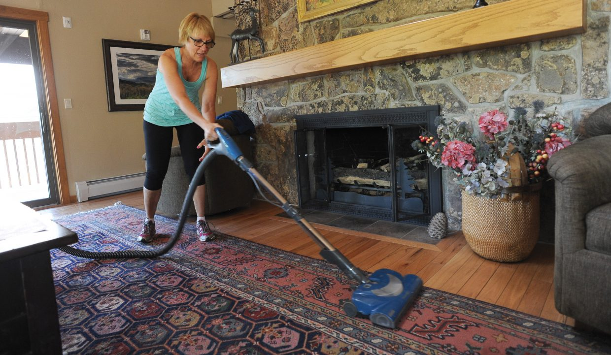 Pam Ruehle, with P.E.O. Sisterhood, vacuums the floor at the Rollingstone Respite House in Steamboat Springs as part of the annual Routt County United Way's Day of Caring.