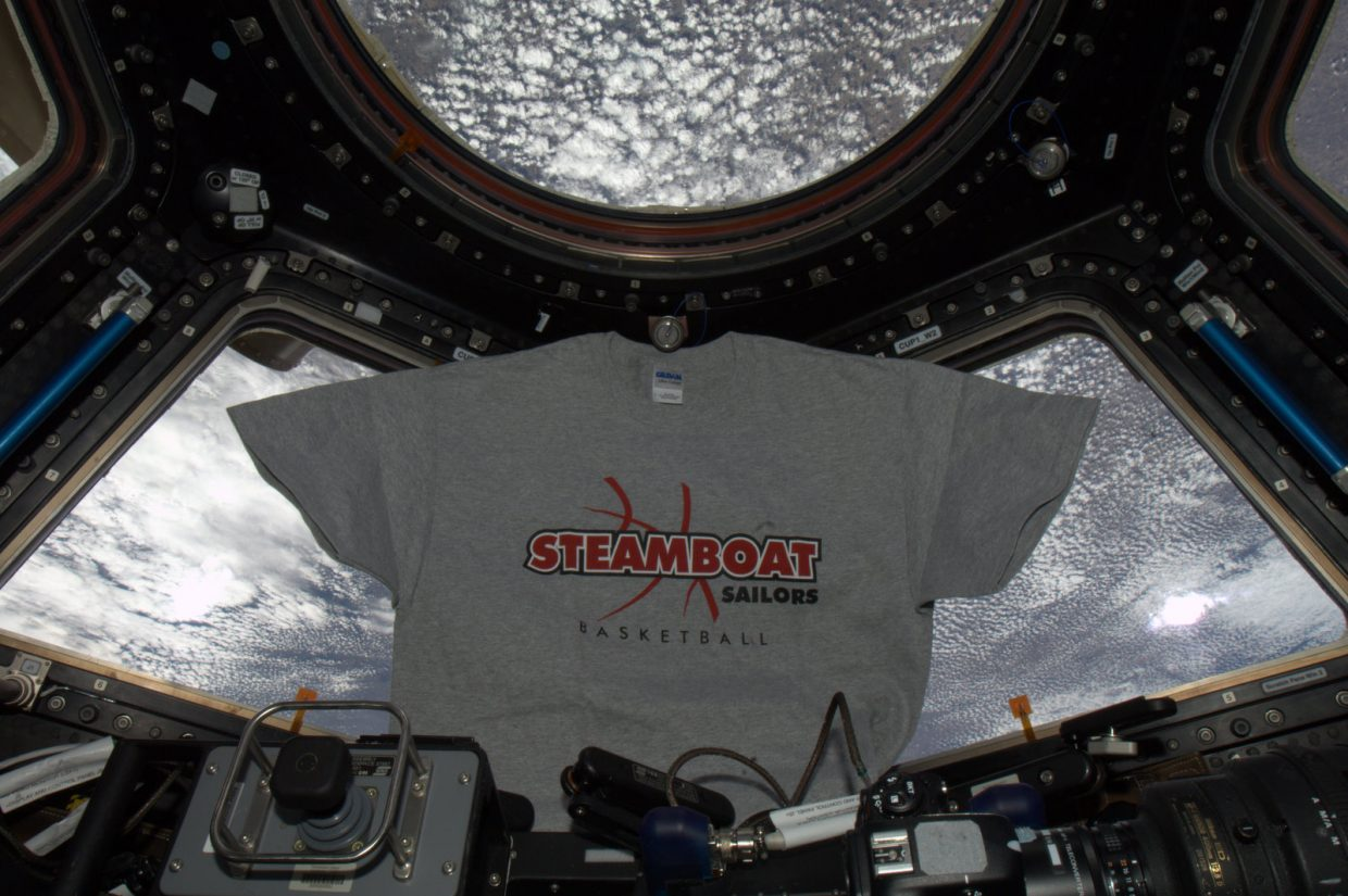A Steamboat Springs High School basketball shirt floats inside the International Space Station. The shirt is the latest piece of Steamboat memorabilia that hometown astronaut Steve Swanson has photographed up in space.