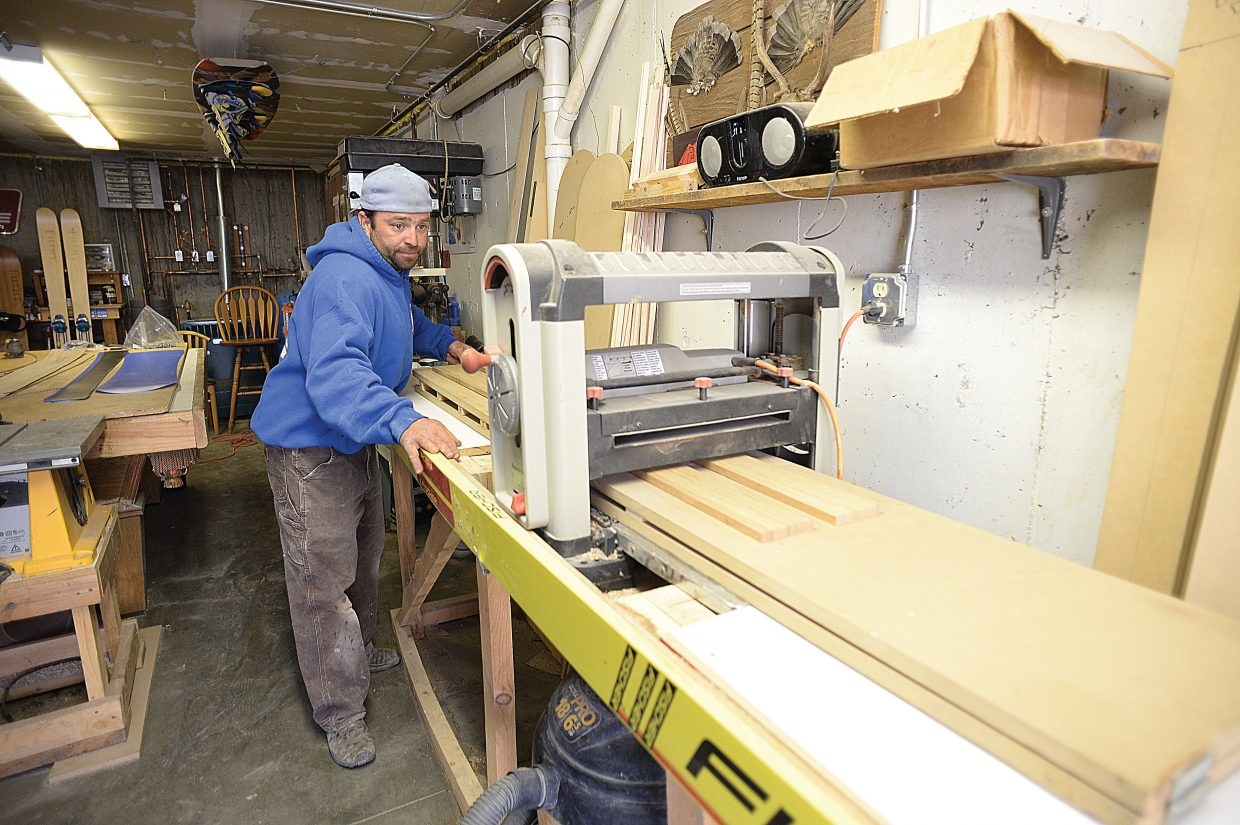 Joe Muhlbauer, owner of Filthy skis and snowboards, uses a machine to plain the wood used for a pair of skis in his garage just outside of Clark. Muhlbauer has been creating his own brand of skis and snowboards out of his garage for the past four years and has developed a good local following. A following he is hoping the brand will continue to grow.