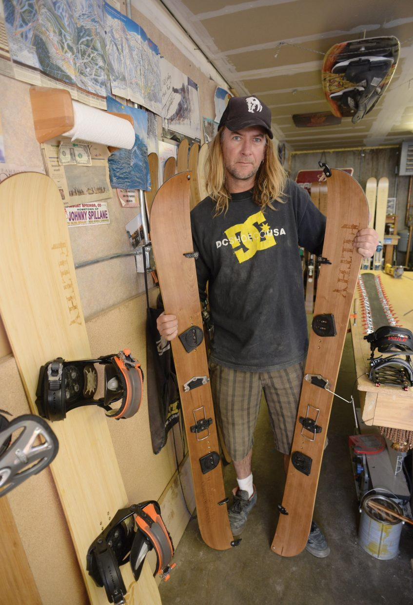 Pete Owen, a partner Filthy skis and snowboards, displays a split board that was created in Joe Muhlbauer's garage just outside of Clark. Muhlbauer ahs creating his own brand of skis and snowboards for the past four years and has developed a good local following. A following he is hoping the brand will continue to grow.