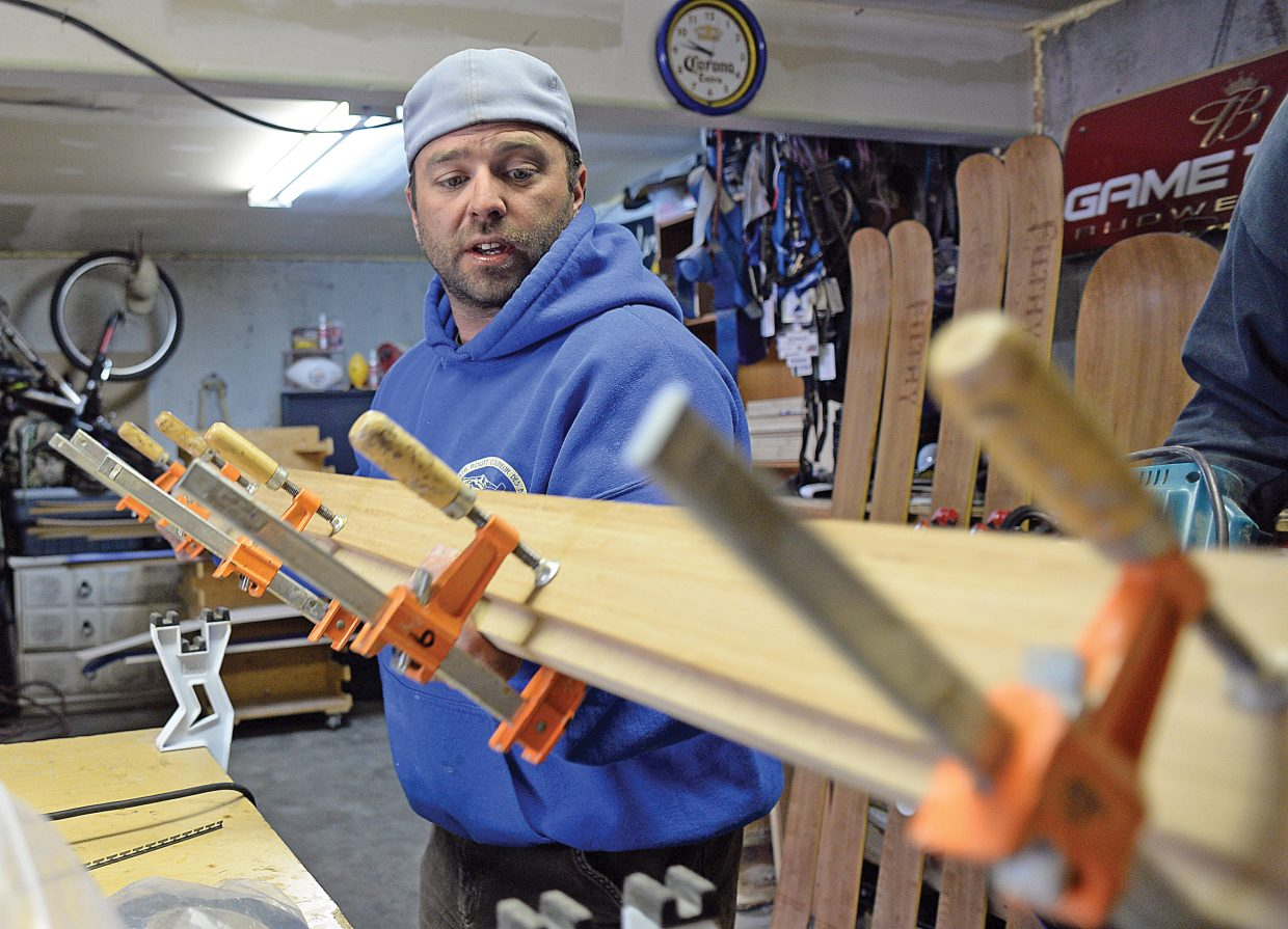 Joe Muhlbauer, owner of Filthy skis and snowboards, clamps a pair of skis to a template before while making a pair of skis in his garage just outside of Clark. Muhlbauer has been creating his own brand of skis and snowboards out of his garage for the past four years and has developed a good local following. A following he is hoping the brand will continue to grow.