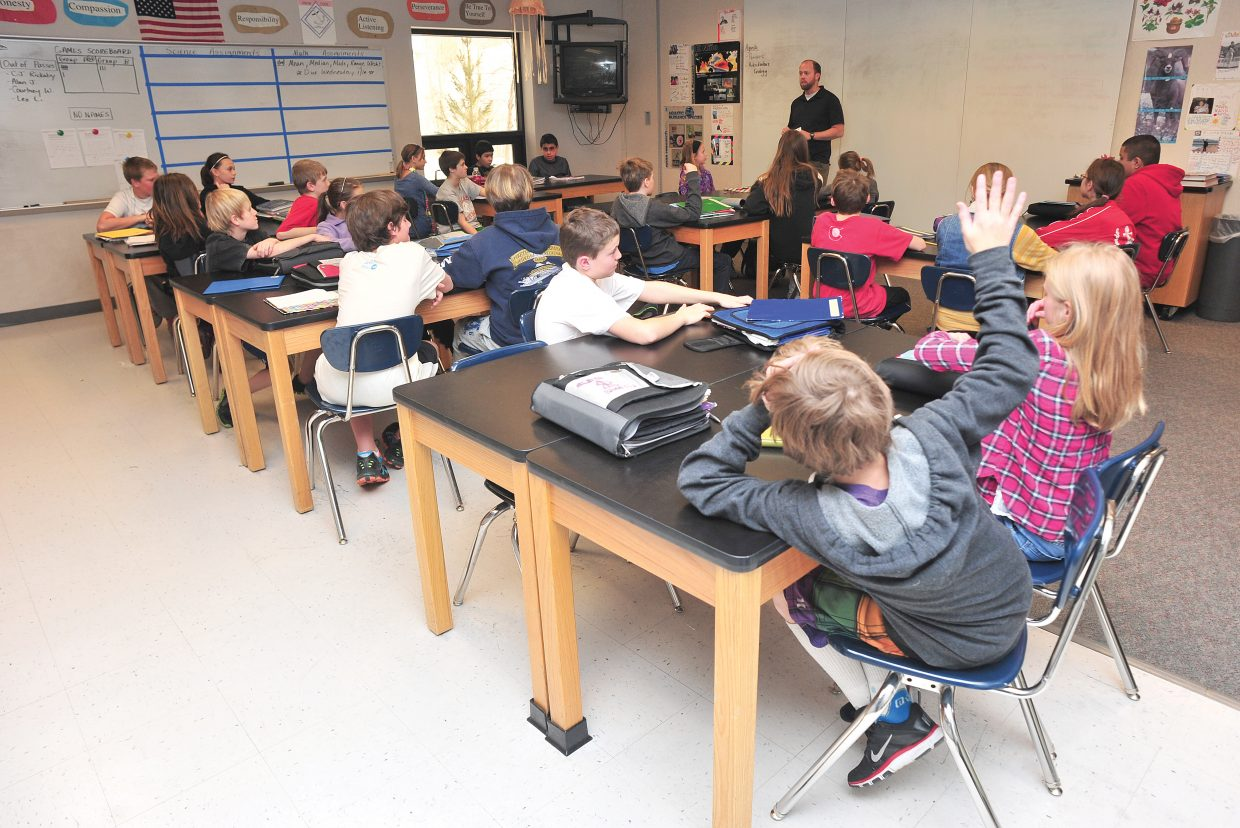 Students listen during a sixth-grade science class at Steamboat Springs Middle School in 2013. Many employees in the Steamboat Springs School District have expressed frustration after two school board members Monday voted down an employee compensation package the majority of staff was in favor of.