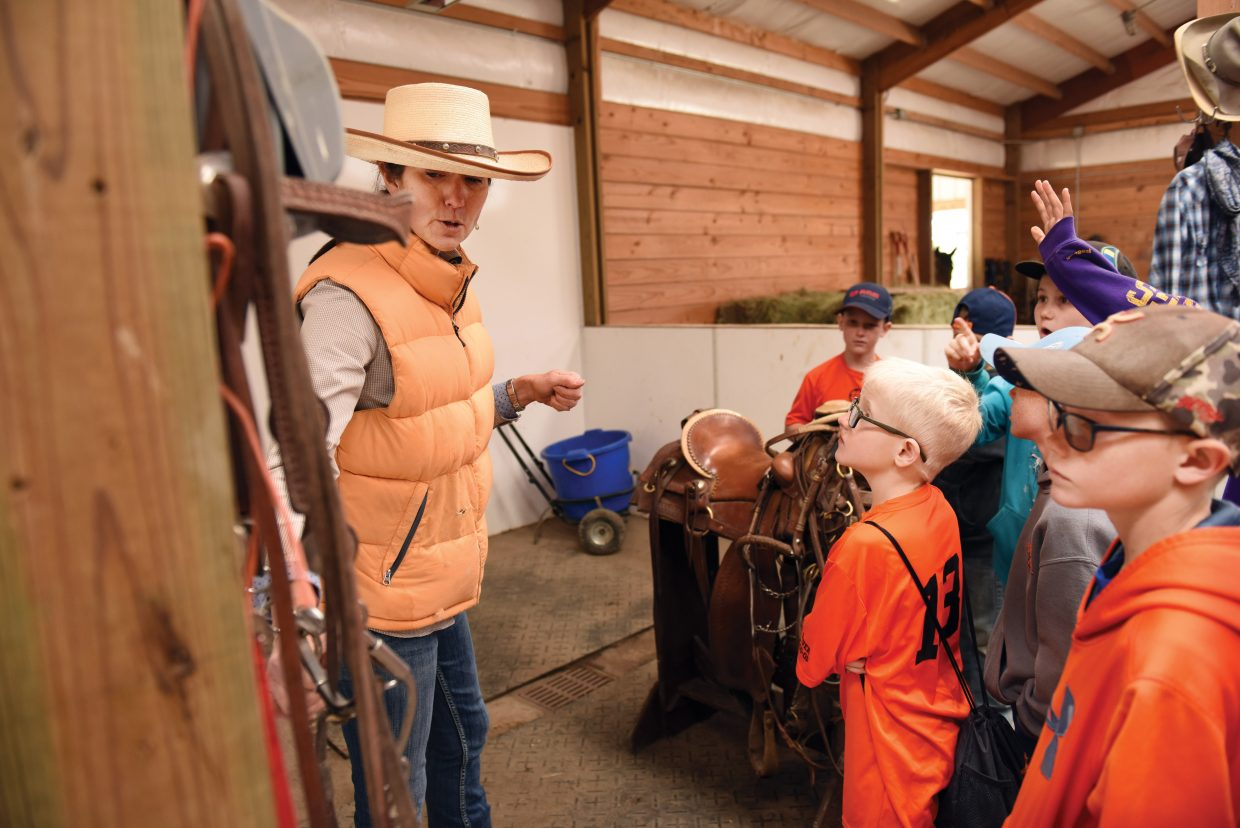 Rancher Erika Murphy, who owns the Coyote Creek Ranch with her husband, Jeff Meyers, explains the tools used on the ranch during the 2016 Ranch Days.