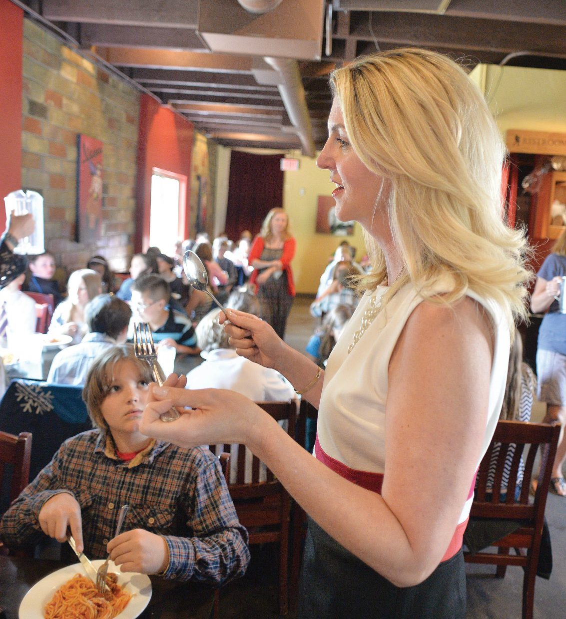 Molly Hayes speaks with fifth-grade students from Soda Creek Elementary School on Thursday about proper manners during the a formal luncheon at Mambo Italiano. The luncheon is an annual event for the elementary aged students who will be moving on to middle school next year.