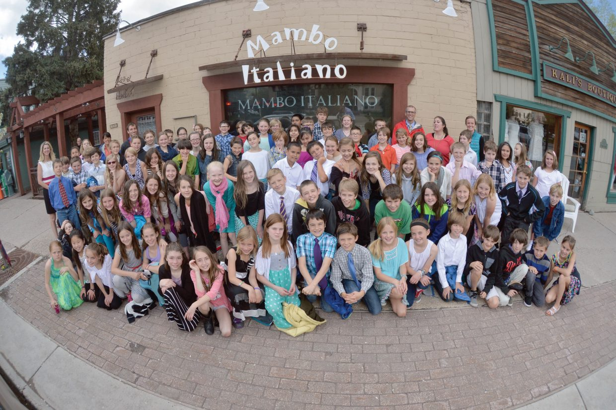 Fifth-graders from Soda Creek Elementary School take a moment for a photo in front of Mambo Italiano on Wednesday. The formal luncheon is the culmination of Molly Manners etiquette lessons taught by Molly Hayes. The meal also is a celebration for the children who are making the transition to middle school.