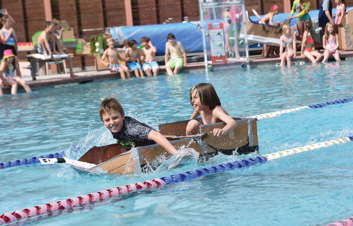 Soda Creek fifth-graders Pedro Effinger (front) and Aspen Ward race to the finish line in the annual Cardboard Classic at the Old Town Hot Springs pool Friday morning. Teams of students built the crafts using nothing more than cardboard and duct tape, then tested them in a race across the pool.