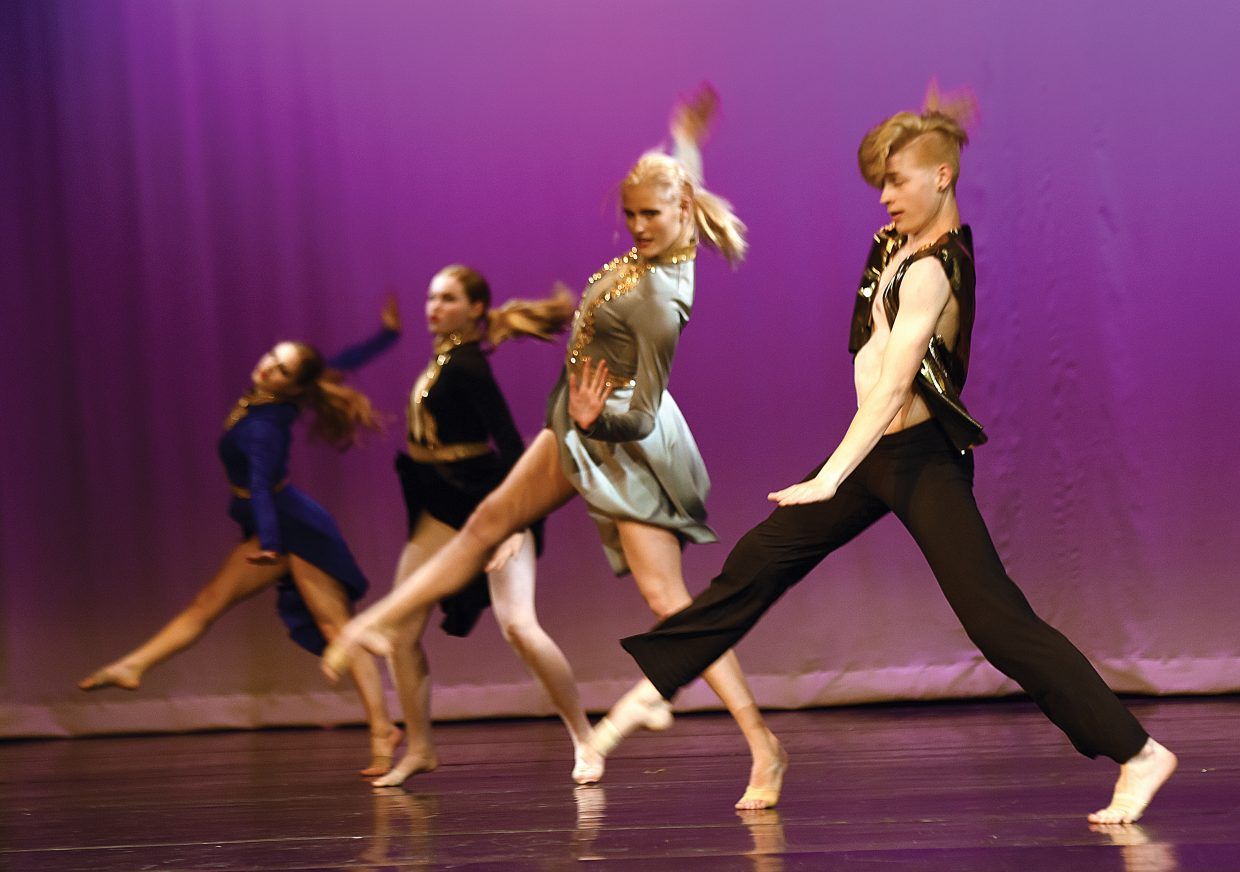 Dancers, from left, Sarah Miller, Delaney Johnston, Taylor Kreissig and Marty St-Pierre rehearse their performance for the Elevation Dance Studio's Passport to Dance.