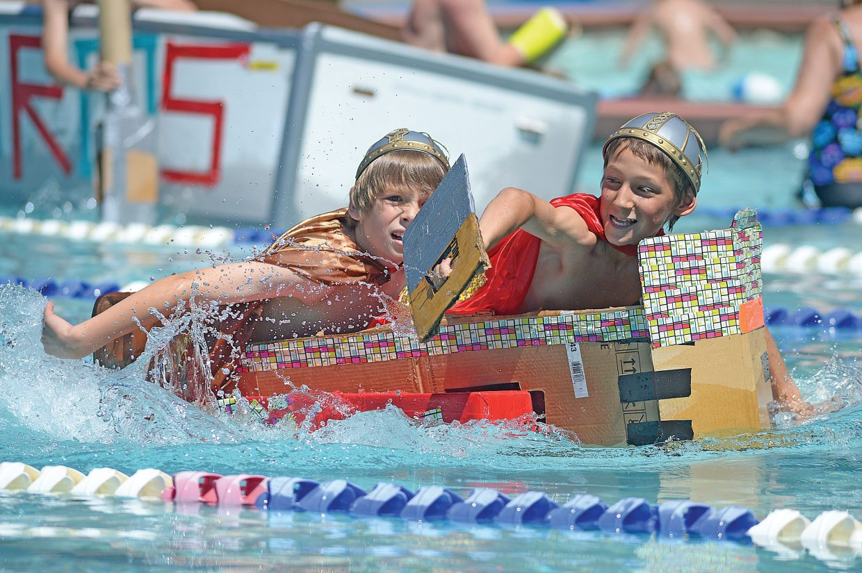 Strawberry Park Elementary School students Jack Quinn-Klynes, front, and Calvin Zuschlag head toward the finish line Wednesday during the Cardboard Classic at the Old Town Hot Springs. The race featured fifth grade students from Soda Creek and Strawberry Park elementary schools who designed, created and then raced boats built with nothing more than cardboard and duct tape.