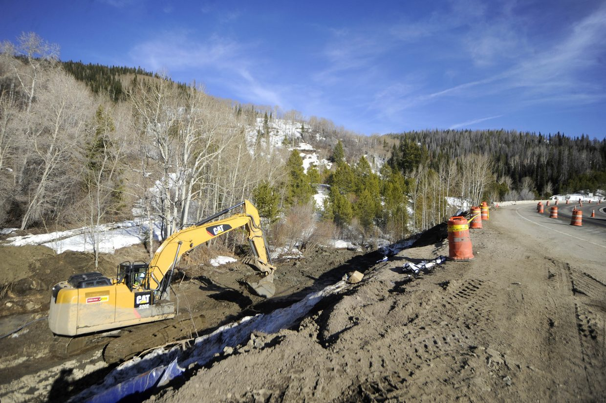 An excavator works to clean up a chemical spill March 17 along U.S. Highway 40 on Rabbit Ears Pass.