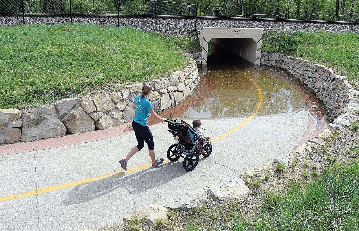 High waters on the Yampa River forced Devon Dalzell and her son Oliver to change their plans to pass through the Island Tunnel on the Yampa River Core Trail on Thursday morning. Several sections of the trail have been closed to flooding.