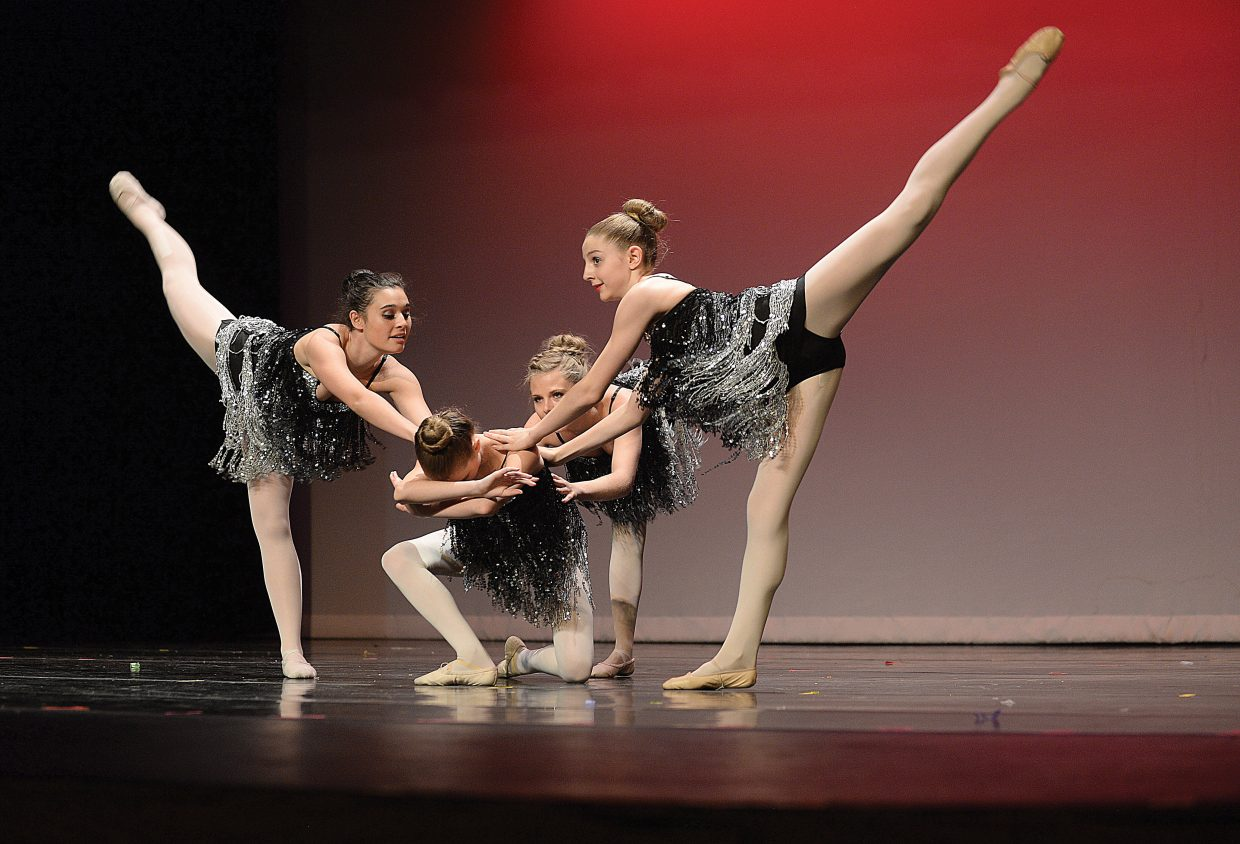 """Dancers Markella Kyprios , right, Olivia Satkiewicz, middle, Anna Henderson, back middle, and Daisy Thunstrom left perform during the Elevation Dance Studios production of """"The Great Gatsby."""" Elevation will host a 6 p.m. performance tonight as well as performances at noon and 6 p.m. Saturday at the Steamboat Springs High School auditorium."""