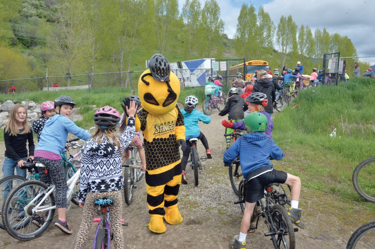 Buzz the Honey Stinger Bee greets students at the Strawberry Park Bike Rally Friday morning.