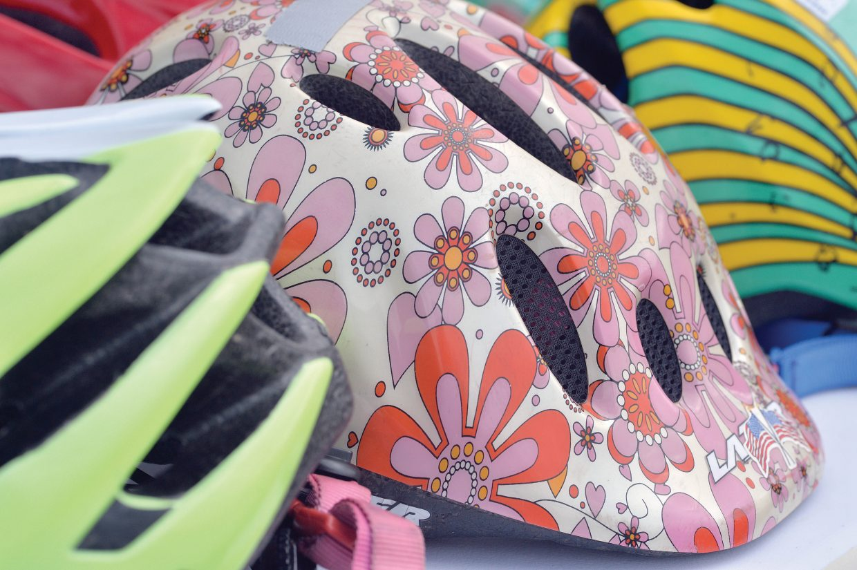 Helmets line a table at the Strawberry Park Elementary School's Bike Rally Friday morning.