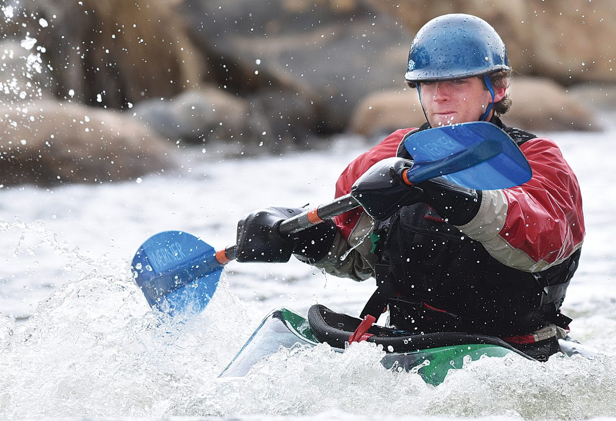 Kayaker Kevin Finch plays in Charlie's Hole on the Yampa River in late March. Local emergency officials recommend wearing proper thermal protection and a personal flotation device before entering local rivers and creeks this spring, as waters are cold and fast-moving.