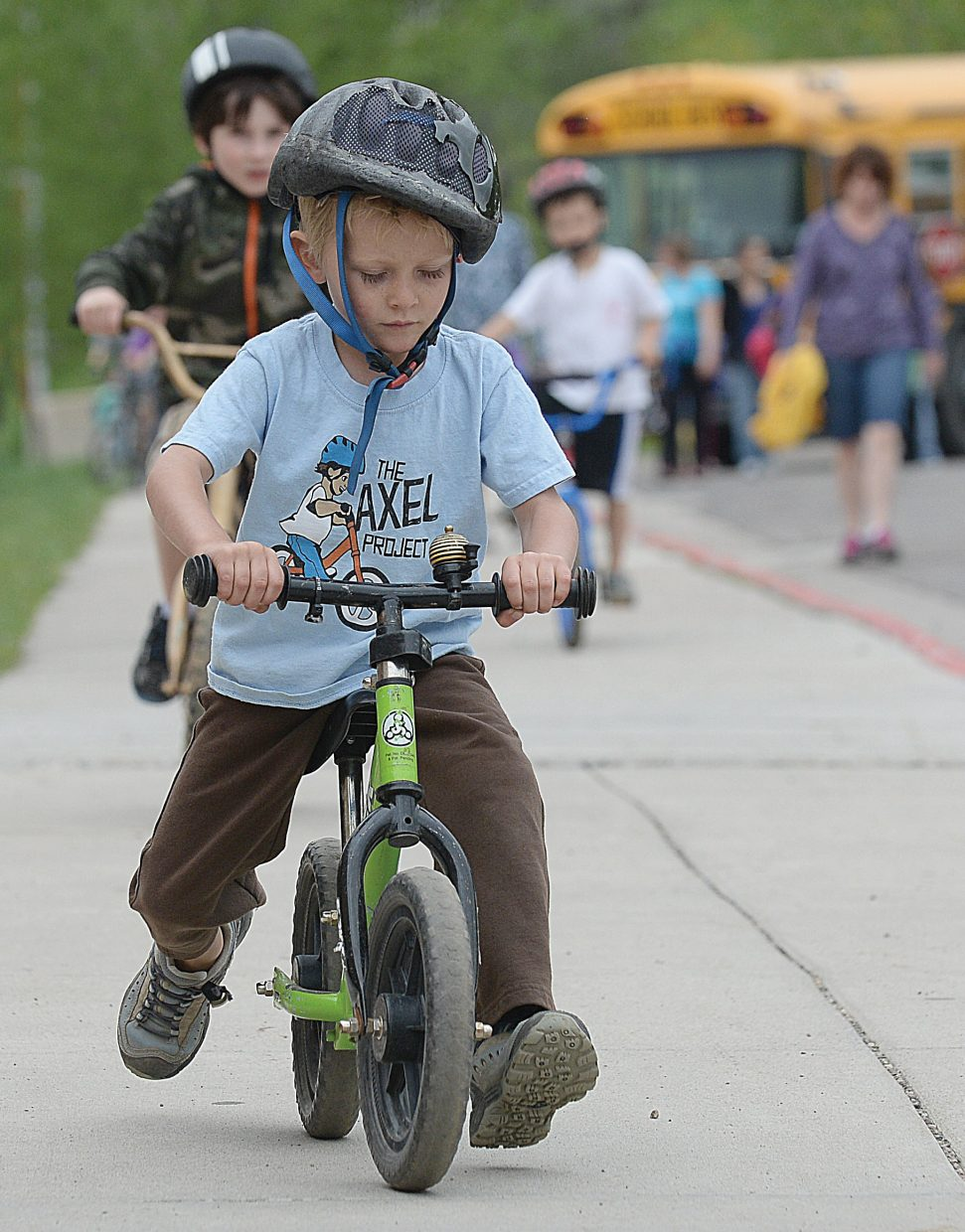 Fergus Kemp rides his strider during the Strawberry Park Elementary School Bike Rally on Friday morning. Young Fergus wasn't quite old enough to go to class yet but was at the rally along with his brother Mason, who is a kindergartner.