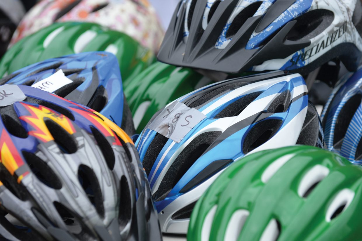 Bike helmets lay in a pile on a table Friday at the Strawberry Park Bike Rally.