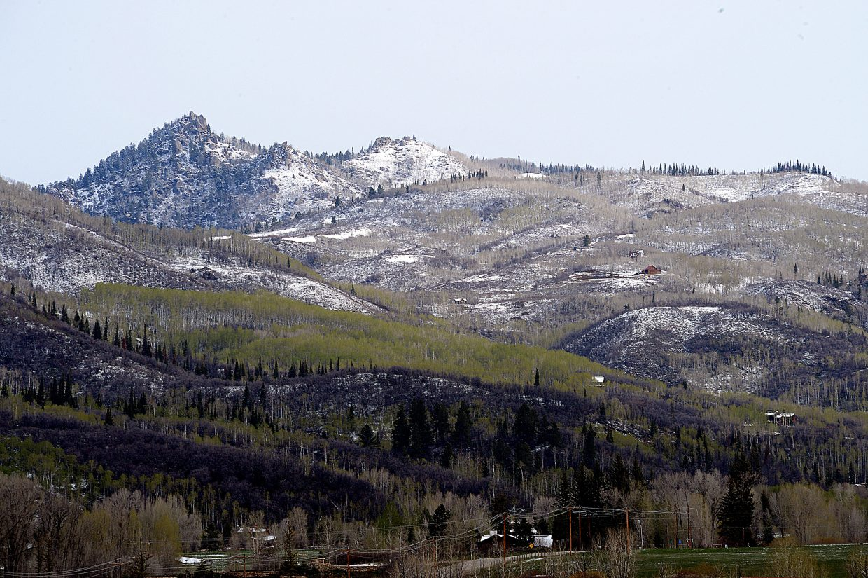 A fresh coat of snow lines the peaks surrounding Strawberry Park near Steamboat Springs on Monday morning.