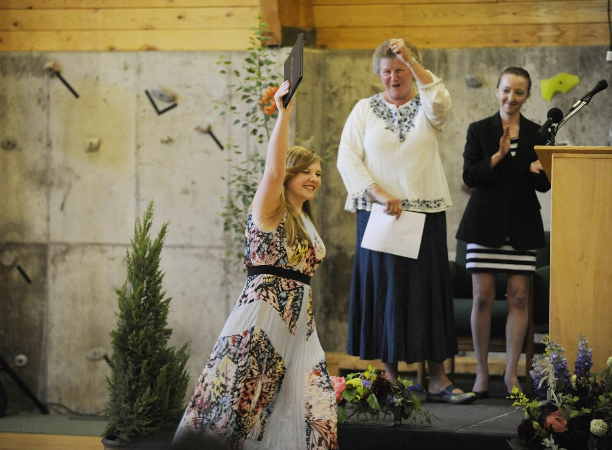 Paige Eivins celebrates receiving her diploma Saturday during the Steamboat Mountain School graduation.