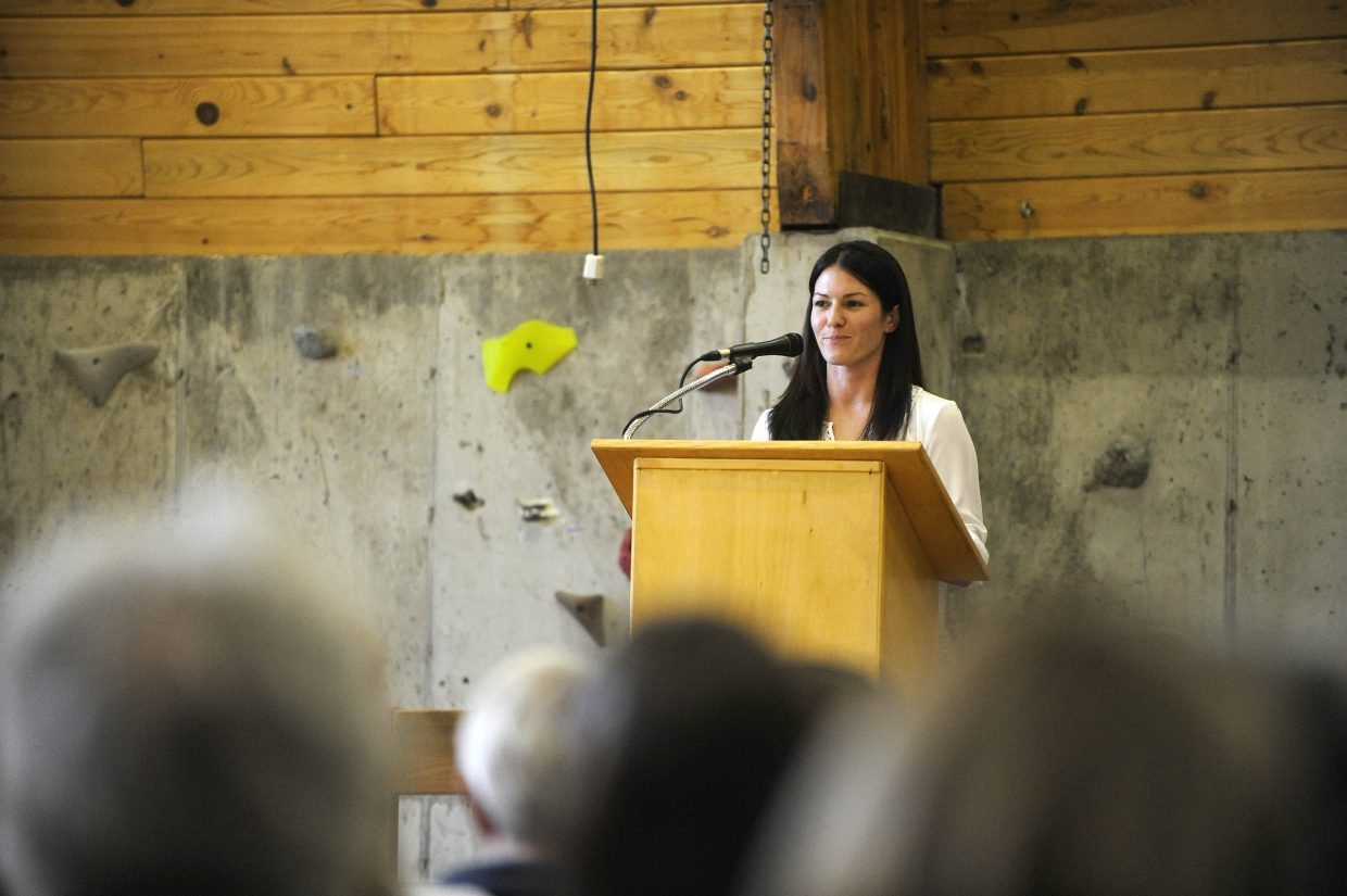 2003 Lowell Whiteman School graduate Eliza Outtrim gives the commencement speech Saturday.