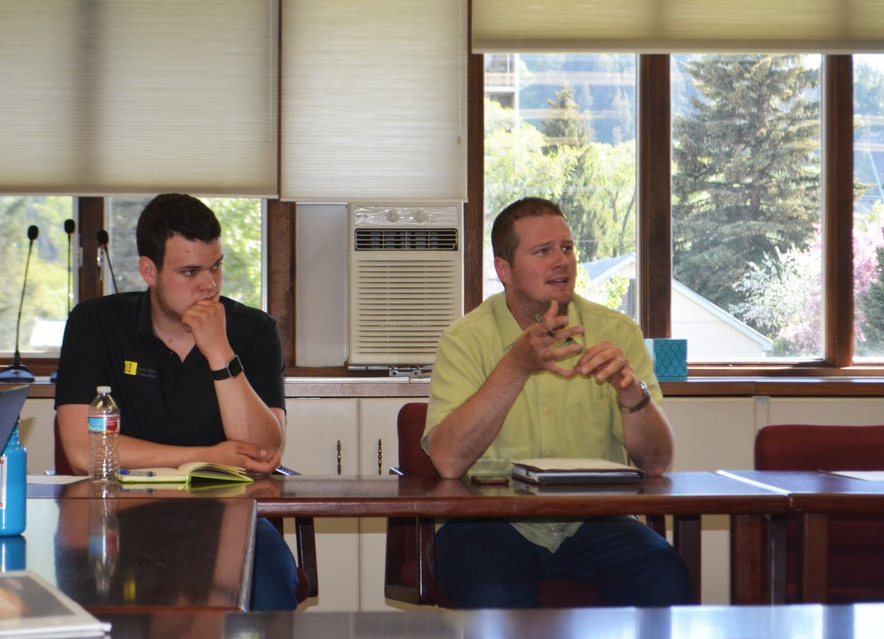 Community Committee for Education member Liam Hahn, a Steamboat Springs High School student, listens as member Collin Kelley speaks during a committee meeting.