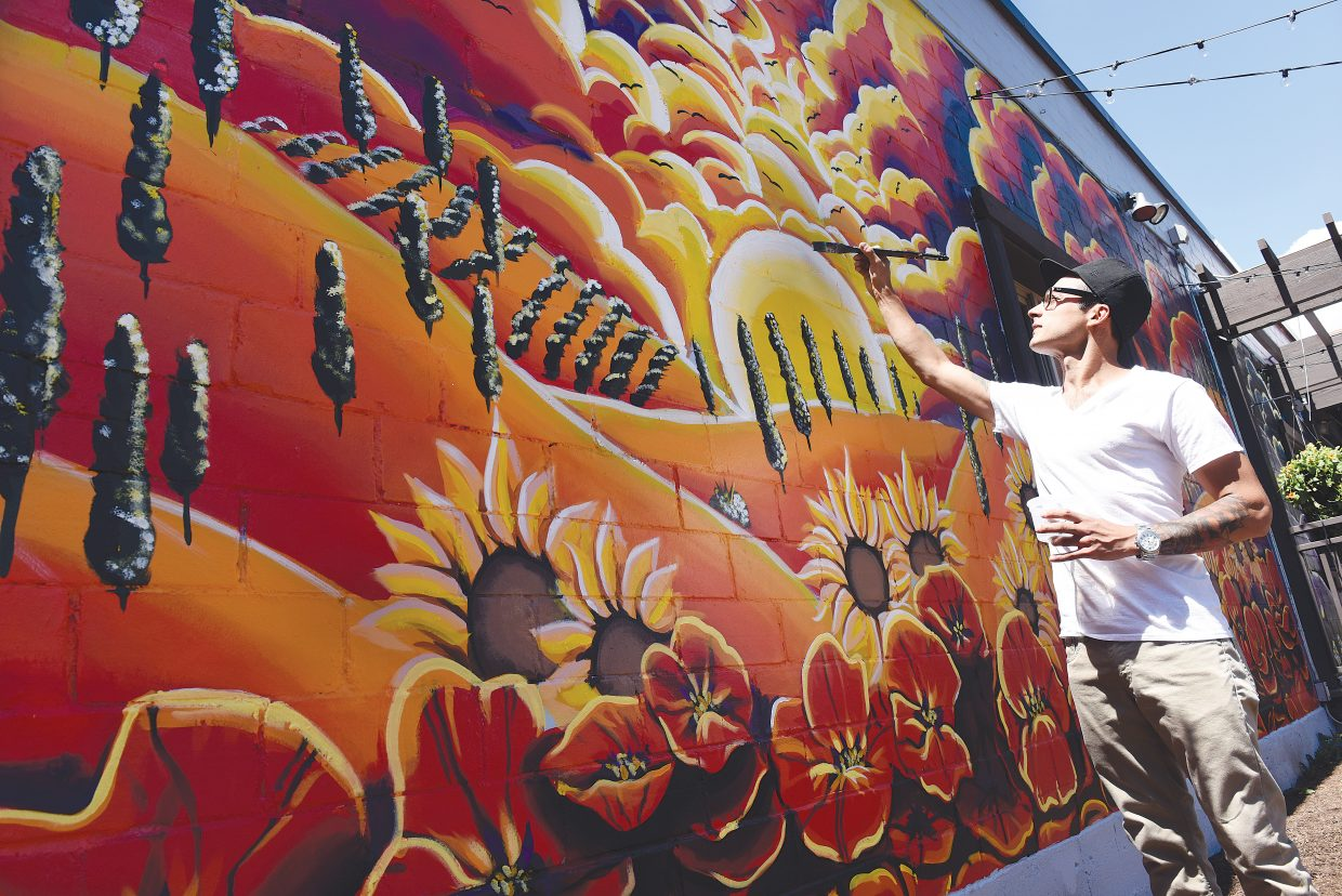 Artist Fernando Maldonado, a chef at Mambo Italiano, has spent the past month designing and painting this mural that gives the outdoor space at the downtown restaurant a Tuscan feeling. Although Steamboat Springs was not selected as one of the Certified Colorado Creative Districts, the steering committee and Steamboat Springs Arts Council will continue to make strides towards the designation in the future.
