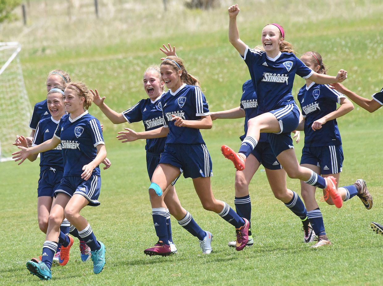 Steamboat's U-14 girls navy team celebrates after winning a shootout, 4-3, against the Rocky Mountain Cougars in the finals of the Real Cup at Aurora Sports Park Monday afternoon.