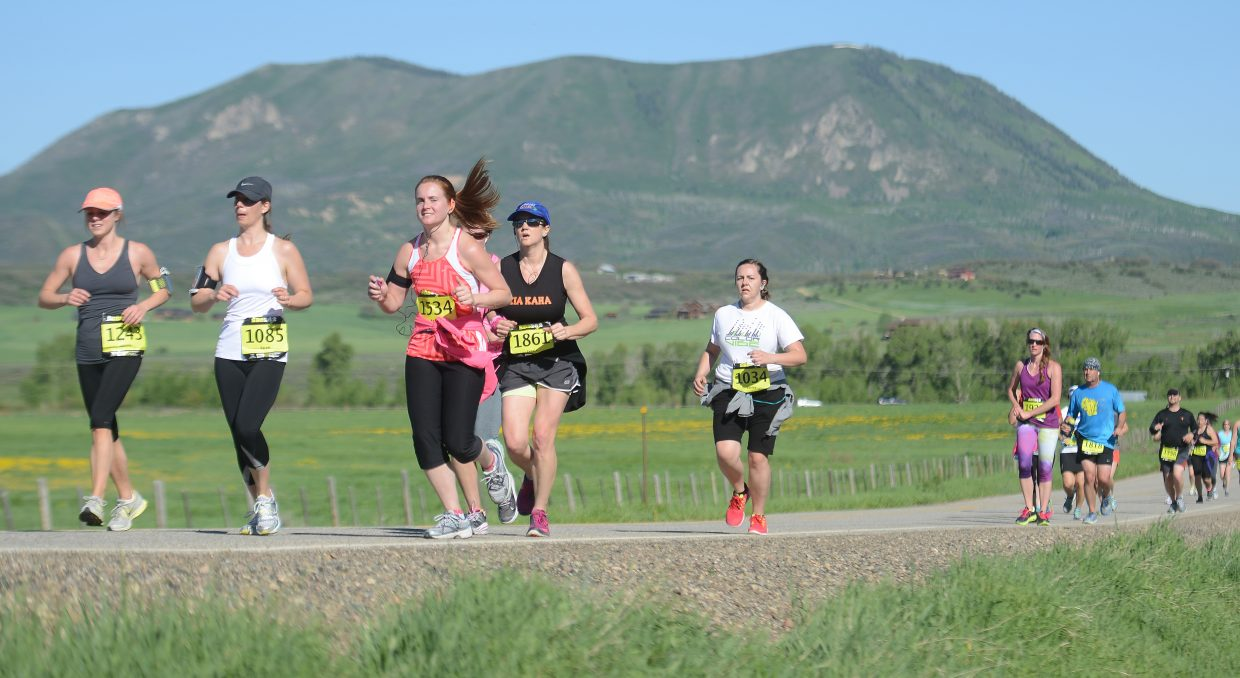 Runners head for town during Sunday's Steamboat Marathon.