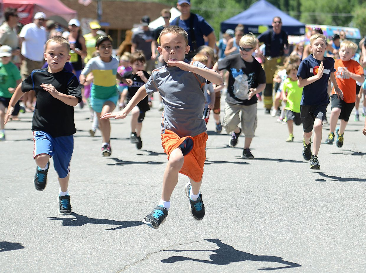 Frank Alexander, 7, helps lead the way during the kid's fun run at the Steamboat Marathon on Sunday.