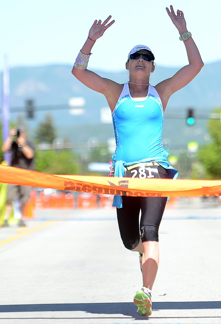 Women's marathon winner Andrea Wilhelm, from Steamboat Springs, crosses the finish Sunday during the Steamboat Marathon.