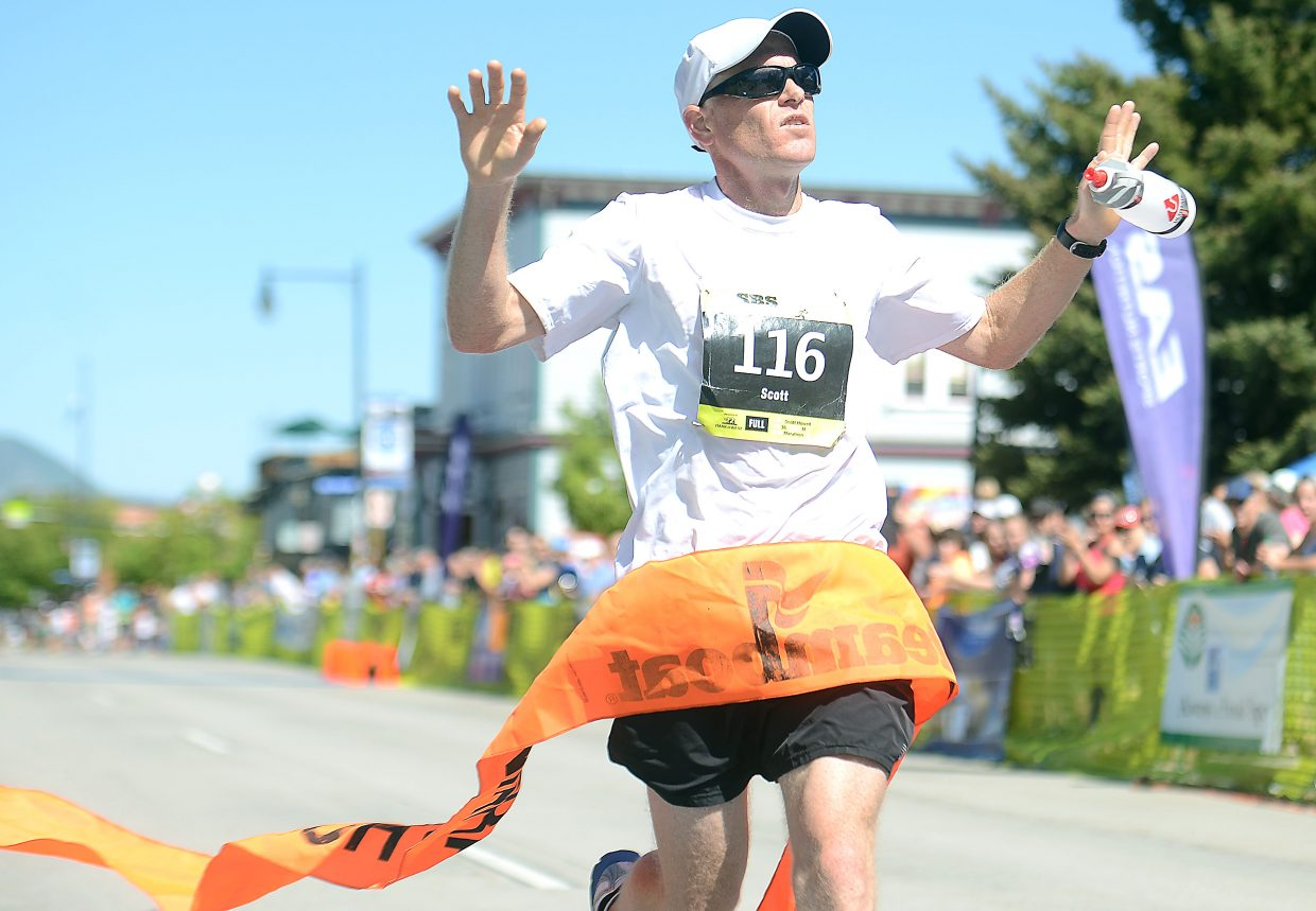 Scott Howell crosses the finish line in the Steamboat Marathon. Howell won the event with a time of 2 hours, 53 minutes and 53 seconds.