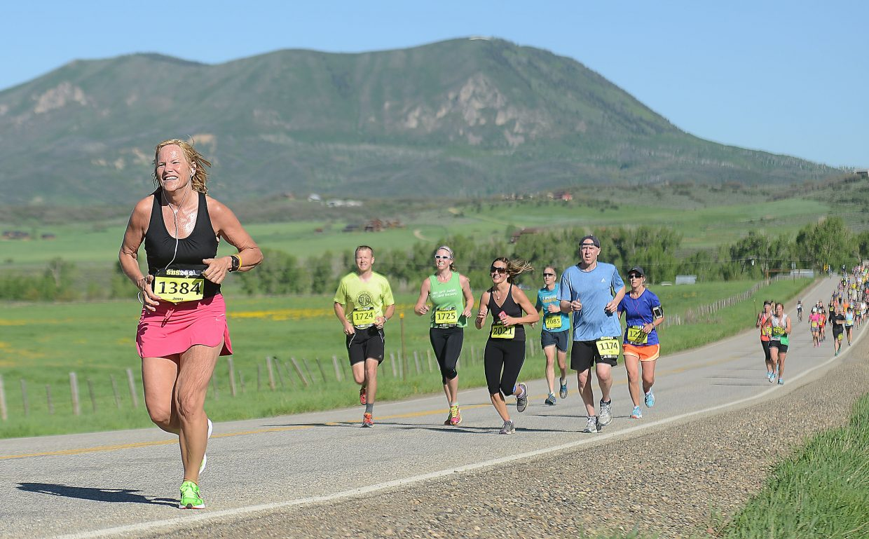 Jenny Hess, from Pickerington, Ohio, helps lead a pack of runners during Sunday's Steamboat Marathon. The event drew nearly 1,500 racers for marathon, half-marathon and 10-kilometer races.