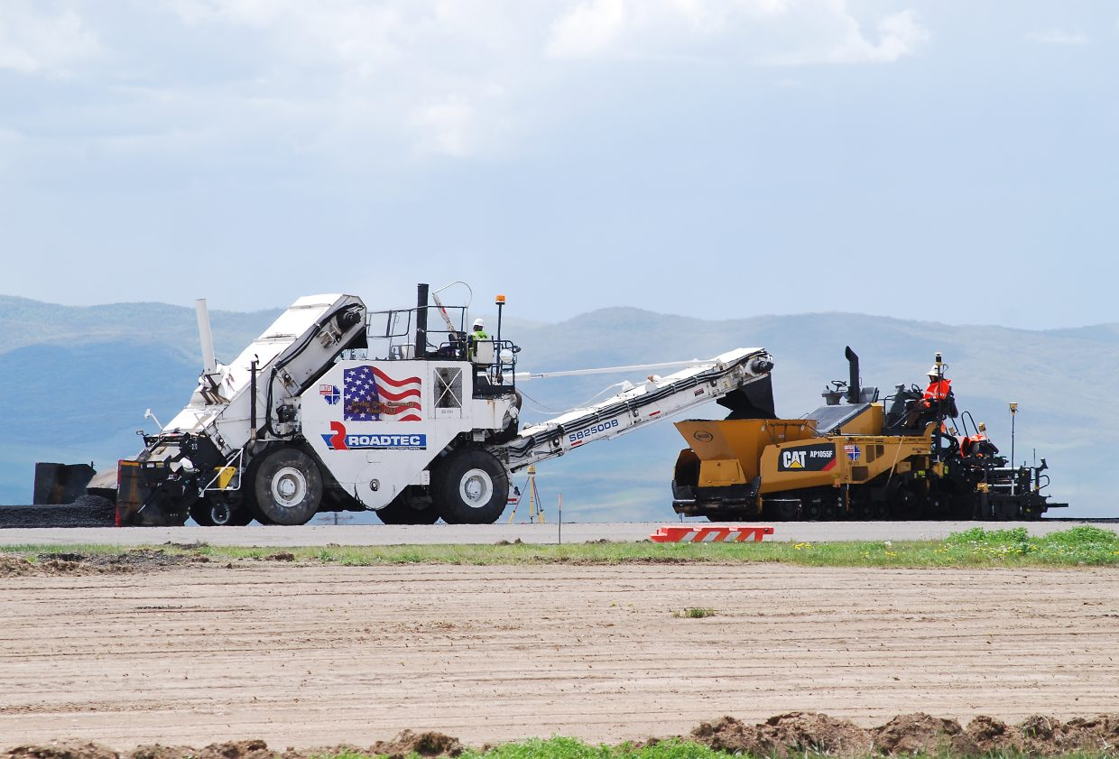Crews were making progress earlier this month on runway repaving at Yampa Valley Regional Airport in Hayden, but the cumulative effect of 4.19 inches of rain in May compared to the normal of 1.7 inches, led the airport director Monday to delay the re-opening date from June 15 to June 25.
