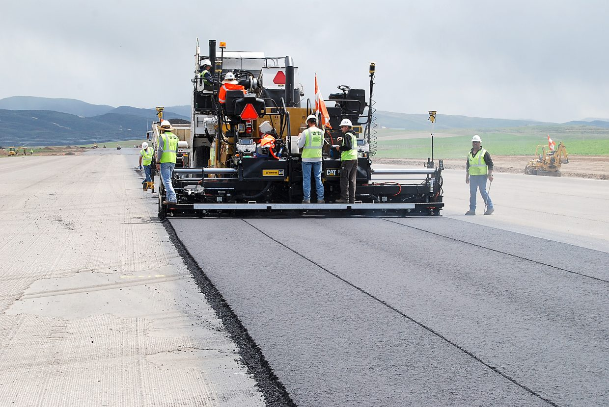 Paving crews working on the Yampa Valley Regional Airport runway overlay have lost 16 full days of work due to rain, causing the airport director to delay re-opening from June 15 to June 25.