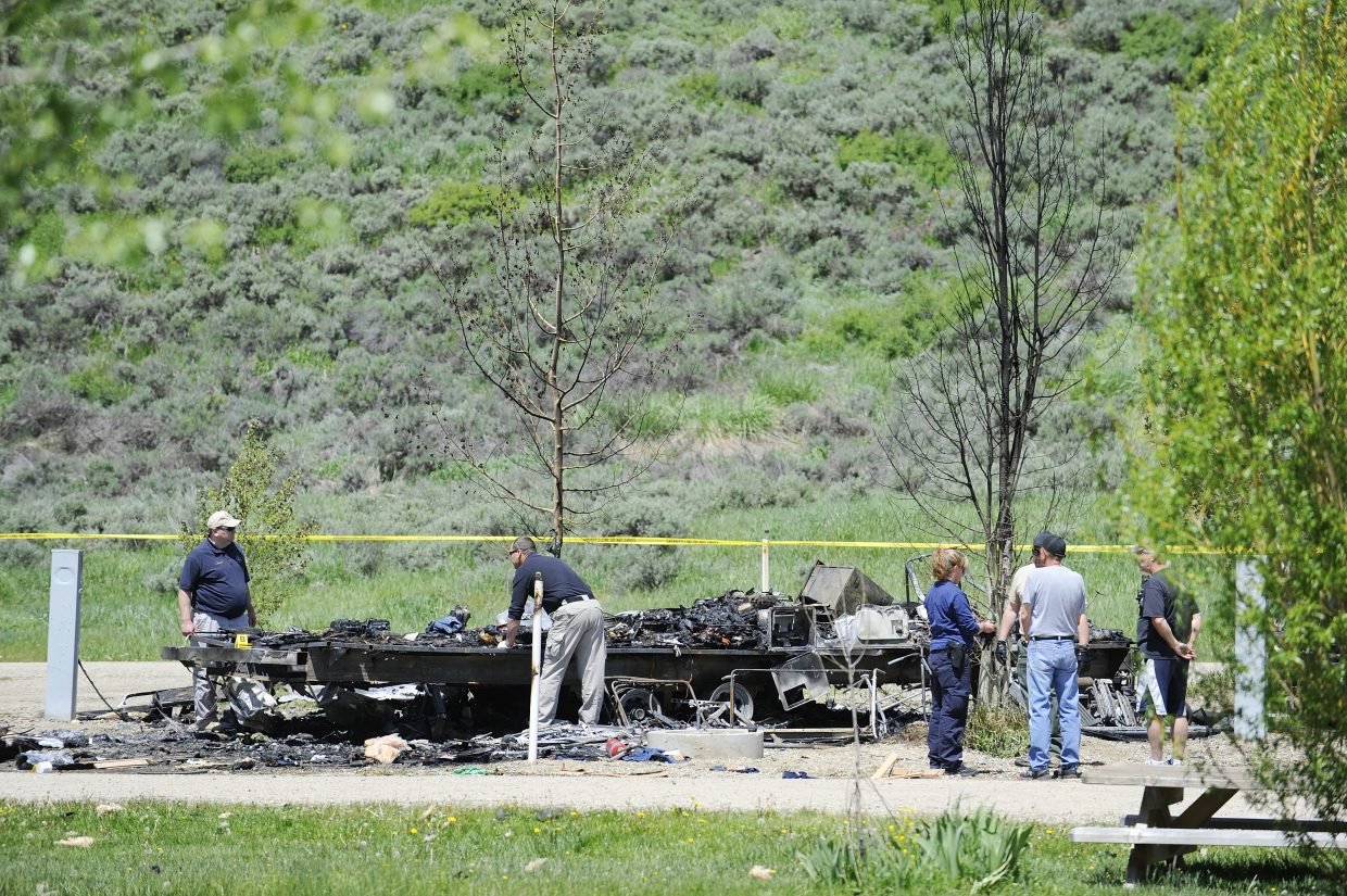 Investigators search through what remains of a camper that exploded May 31 at Eagle Soaring RV Park.