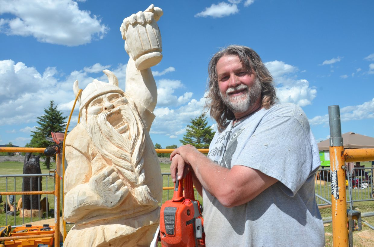 Robert Waits, of Diamond Springs, California, poses with his half-finished viking during the 2014 Whittle the Wood Rendezvous at Loudy-Simpson Park. Waits is among the carvers scheduled to compete in this year's event, which begins June 17.
