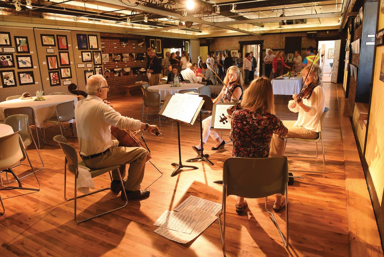 "A string quartet performs for visitors in the Depot Arts Center recently as part of a tour to showcase Steamboat's diverse arts community. On Saturday, the Steamboat Springs Arts Council will host ""ART-Tini"" for an evening of plays, prose, music and martinis."