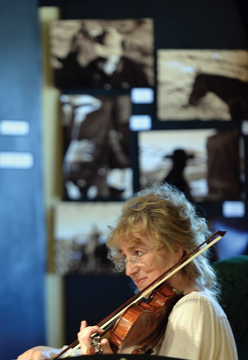 Violinist Bonnie Murray performs as part of a string quartet for visitors in the Depot Arts Center on Wednesday as part of a tour to showcase Steamboat's diverse arts community. An advisory group, led by the Steamboat Springs Arts Council, led a walking tour Wednesday for members of the Colorado Creative Industries. The group is hoping to have the downtown area designated as an arts district.