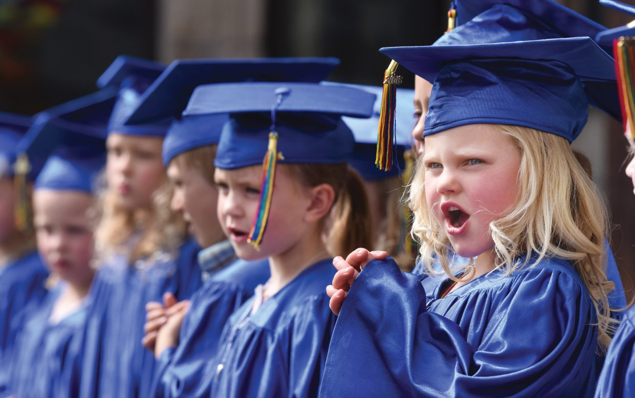Simone Bastone-Russell sings during the Holy Name Pro-School's graduation ceremony Thursday afternoon. The young students celebrated the completion of pre-school as they look forward to the start of kindergarten next fall.