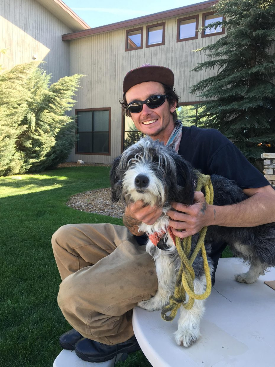 Lance Koch and his dog, Bella, shared a little wisdom with a stranger while hitchhiking through Steamboat Springs on June 2.