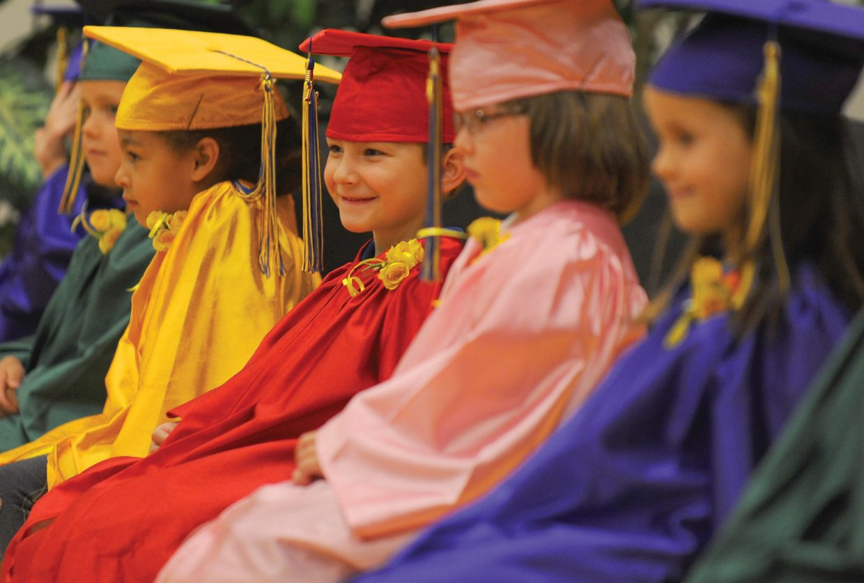 Kindergartner Seth Tyree listens during the Heritage Christian School kindergarten graduation Tuesday afternoon at the school west of Steamboat Springs. Eleven students graduated and will move onto first grade next year.